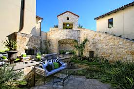 horseshoe bay eclectic spanish lake house courtyard sitting area