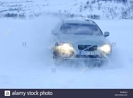 volvo sweden car driving on snow and ice near the arctic circle in sweden