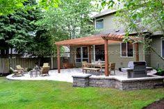 Backyard Patios With Fire Pits by Paver Patio Pergola Fire Pit Seat Wall Lighting U2013 Contemporary