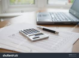 Office Desk Close Up Laptop Pen Calculator On Table Paperwork Stock Photo 27252730