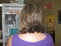 layered flip hairstyles images tagged haircut stacked flip layers uniquely elegant salon spa