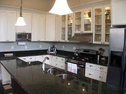 tuba granite countertops with white cabinets black white kitchen