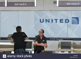 united airlines media baggage washington dc usa 8th july 2015 a passenger checks in baggage