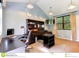 blue modern home office with dark brown furniture stock image