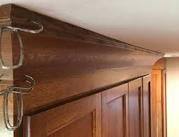 how to install cabinets with uneven ceiling hiding a wavy ceiling in crown molding homebuilding