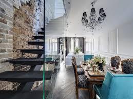 black steel staircase with frameless glass balustrade exposed