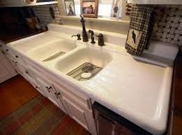 modern kitchen sink with drain boards and chrome faucet stylish cast iron kitchen sink with drainboard modern house plans