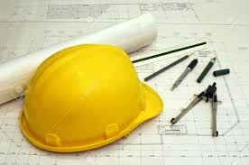 floor plans and a hard hat with various drawing tools scale