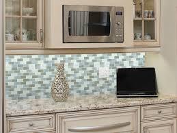khaki glass tile kitchen backsplash with white cabinets u0026