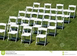 white wedding chairs rows of white wedding chairs royalty free stock photography