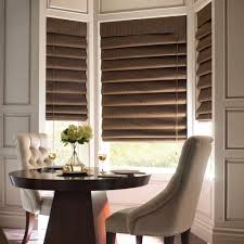 interior design white window with brown bali blinds plus dining