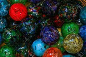 pile of multi colored blown glass balls in vairing sizes stock