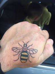 hand tatoo image the manchester bee a symbol of hope and the many tattoos to