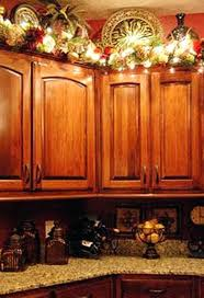 christmas decorations for kitchen cabinets top of kitchen cabinet christmas decorating ideas kitchen cabinet