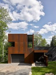 contemporary canadian lake house features black dyed cedar and