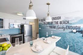 Coastal Kitchens Pinterest by An Oversized Wall Decal With A Beachy Quote Adds Personal Style To