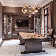 white hang lamp inside room with black pool tables on the black