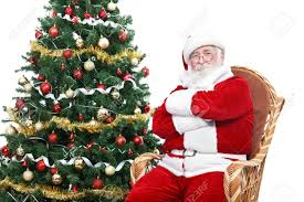santa claus sitting in rocking chair with crossed arms and relax