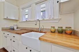 Farm Sink With Backsplash by Cottage Kitchen With Mexican Tile Backsplash U0026 European Cabinets