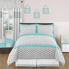 grey comforter large rustic wooden headboard turquoise geometric
