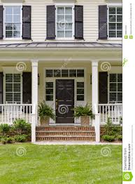 white colonial house porch and plants stock photo image 56661754
