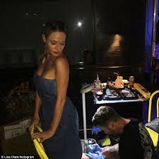 ex big brother u0027s lisa clark gets ankle tattoo at glue denim party