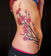 women show brilliant flower tattoo design image make on side