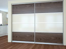 modern dressing room with fitted wardrobes sliding doors and