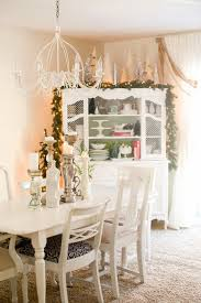 domestic fashionista natural and white christmas dining room to fill in the new empty space keeping a collection of candles on our dining table filled it in while adding a little
