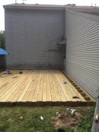 Covering Old Concrete Patio by From Dirt To Deck How To Build A Ground Level Deck The Wolven
