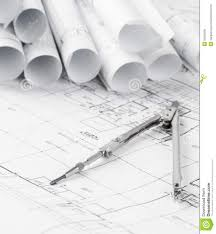 rolls of architecture blueprints and house plans stock