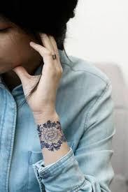 tattoo on top of wrist small floral tattoo wrist google search tattoo s pinterest