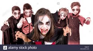 group of kids with face paint and halloween vampire costumes stock