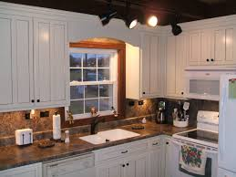 travertine countertops antique white kitchen cabinets lighting