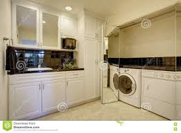 Laundry Room White Cabinets by Small Kitchen Room With Built In Laundry Area Stock Photo Image