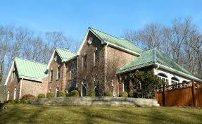 standing seam metal roof in aged copper color metal roofing