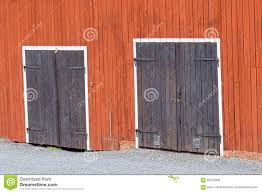 Red Barn Doors by Two Black Doors In A Red Barn Wall Stock Photo Image 62413209