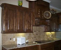 staining kitchen cabinets cool brown porcelain subway tile
