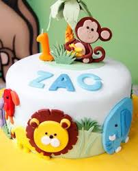 mod monkey birthday cake with matching cupcakes by hotmamascakes