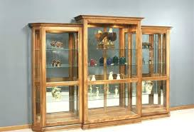 Wall Curio Cabinet With Glass Doors Wall Curios Cabinet Rootsrocks Club
