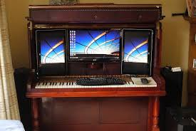 modified piano becomes an awesome concealable computer desk