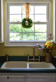 blue ribbon kitchen september 2014 i used a small faux boxwood wreath from ballard designs a dot of hot glue holds it in place with a burlap wired ribbon my hanging window wreath treatment