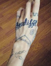 grimes 15 tattoos u0026 meanings steal her style
