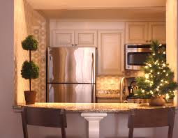 painting stained kitchen cabinets painting stained kitchen cabinets man sanding a door of cabinet