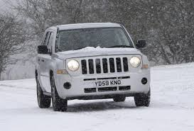 jeep snow tracks jeep patriot station wagon review 2007 2011 parkers