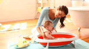 Bathing A Baby In A Bathtub How To Bathe A Baby Parents