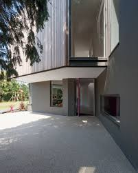 modern home design concepts wedge house by soup architects light pink colored thin pillar