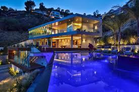 1895 rising glen 90069 hollywood modern home pool at night