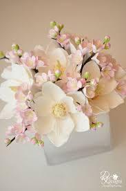 dk designs custom floral arrangement u003d magnolias and plum blossoms