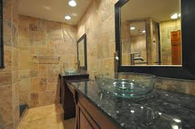 glossy marble countertops with glass vessel sink bathroom
